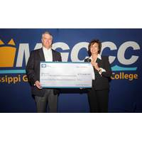 Ingalls Shipbuilding President Brian Cuccias, left, and Mary S. Graham, president of Mississippi Gulf Coast College hold the check representing the donation Ingalls made to MGCCC to purchase welding machines. (Photo: HII)