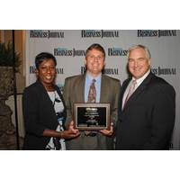 Ed Hagar (center) accepted the Mississippi Business Journal's Healthiest Workplace Award on behalf of Ingalls Shipbuilding. Hagar, Ingalls' manager of compensation, benefits and HRIS, is pictured with Tami Jones, associate publisher of the Mississippi Business Journal, and Murray Harber, executive director of the Mississippi Business Group on Health. (Photo: Bill Glenn/HII)