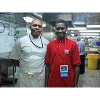 Caleb and chef Serge Nzembele in the galley of Africa Mercy, a floating hospital. (Photo courtesy of Caleb Biney)