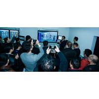 Seen here is WinGD training manager Tyson Liang Qin presenting the W-FMS virtual reality engine room to a delegation of ship owners. (Photo: WInGD)