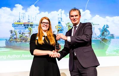 "At the 2019 CEDA Dredging Days, IADC's Secretary General René Kolman (right) bestows the 2nd Young Author Award 2019 to Ms Liesbeth De Keukelaere (left) for her contribution to the paper ""Mapping water quality with drones – test case in Texel"". Photo: IADC"