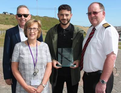 Pictured left to right are Simon Brebner, chief executive  of Peterhead Port Authority; Linda Hope, center manager for the Scottish Maritime Academy; Frazer Smart; and John Forman harbor master, Peterhead Port Authority. (Photo: Sentinel Marine)
