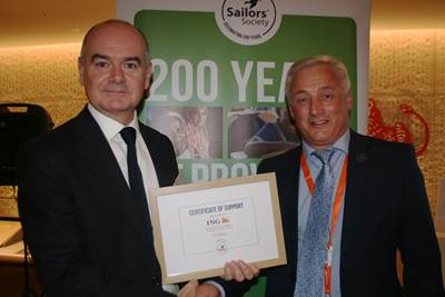 Sailors' Society CEO Stuart Rivers presented ING ship-finance managing director David Grant with a certificate of support (Credit: Geoff Garfield)