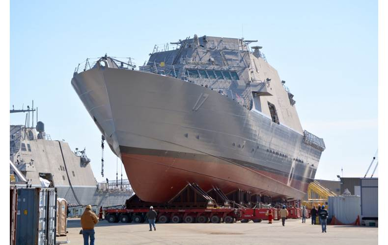 File photo: Littoral combat ship USS Indianapolis (LCS 17) is moved from an indoor production facility in Marinette, Wisc., to launchways in preparation for its upcoming launch into the Menomenee River. (U.S. Navy photo courtesy of Fincantieri Marinette Marine by Val Ihde)
